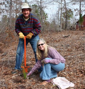 We have a system for planting longleafs. Amanda picks a spot and I pound that orange dibble into it to create a vertical hole. She sticks in a longleaf seedling. While I'm packing the dirt around the seedling, she's off picking the next spot. This makes the most of our gifts, Lee's brute strength and Amanda's taste and intelligence.