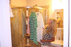 When showers threaten but we still have damp clothes, we've learned we can help them to dry by hanging them in the shower